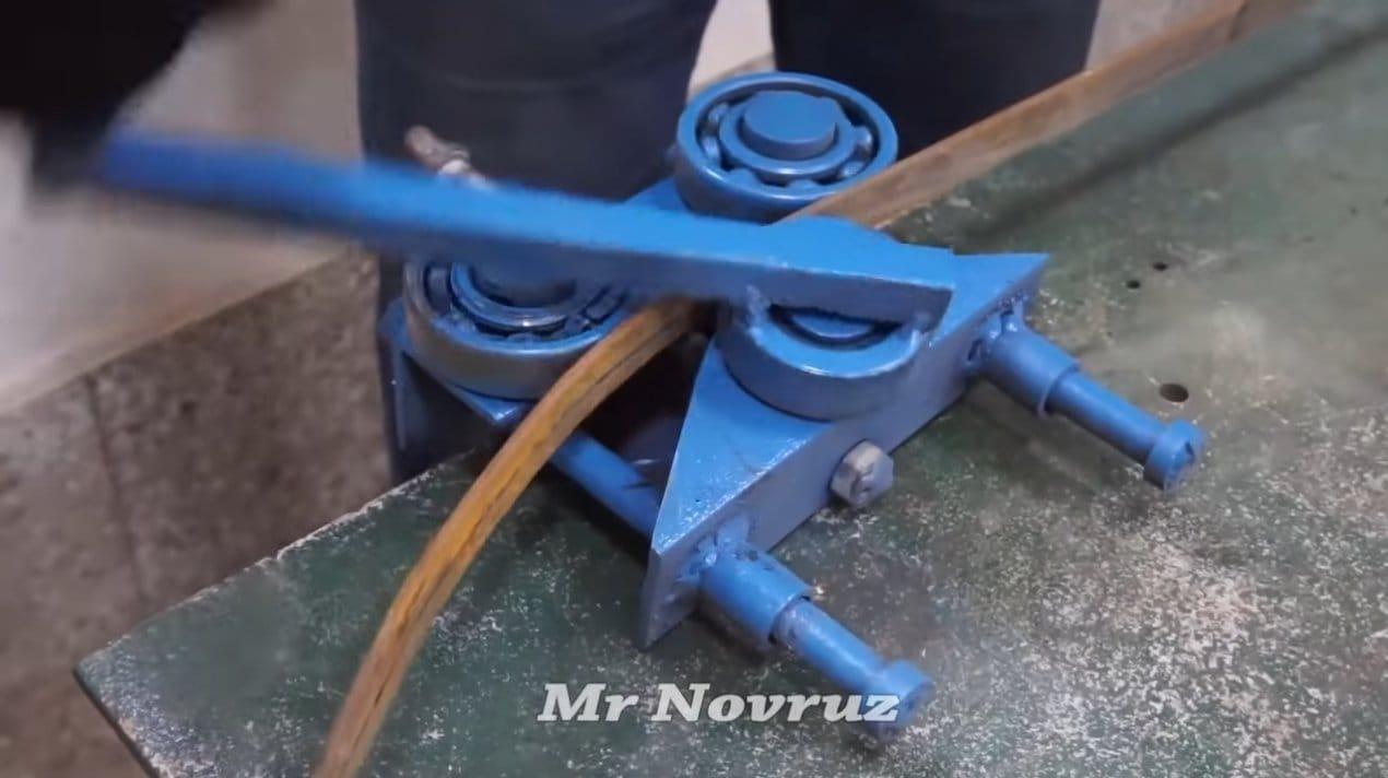 Катушка для наматывания поливочного шланга (из колесного диска)