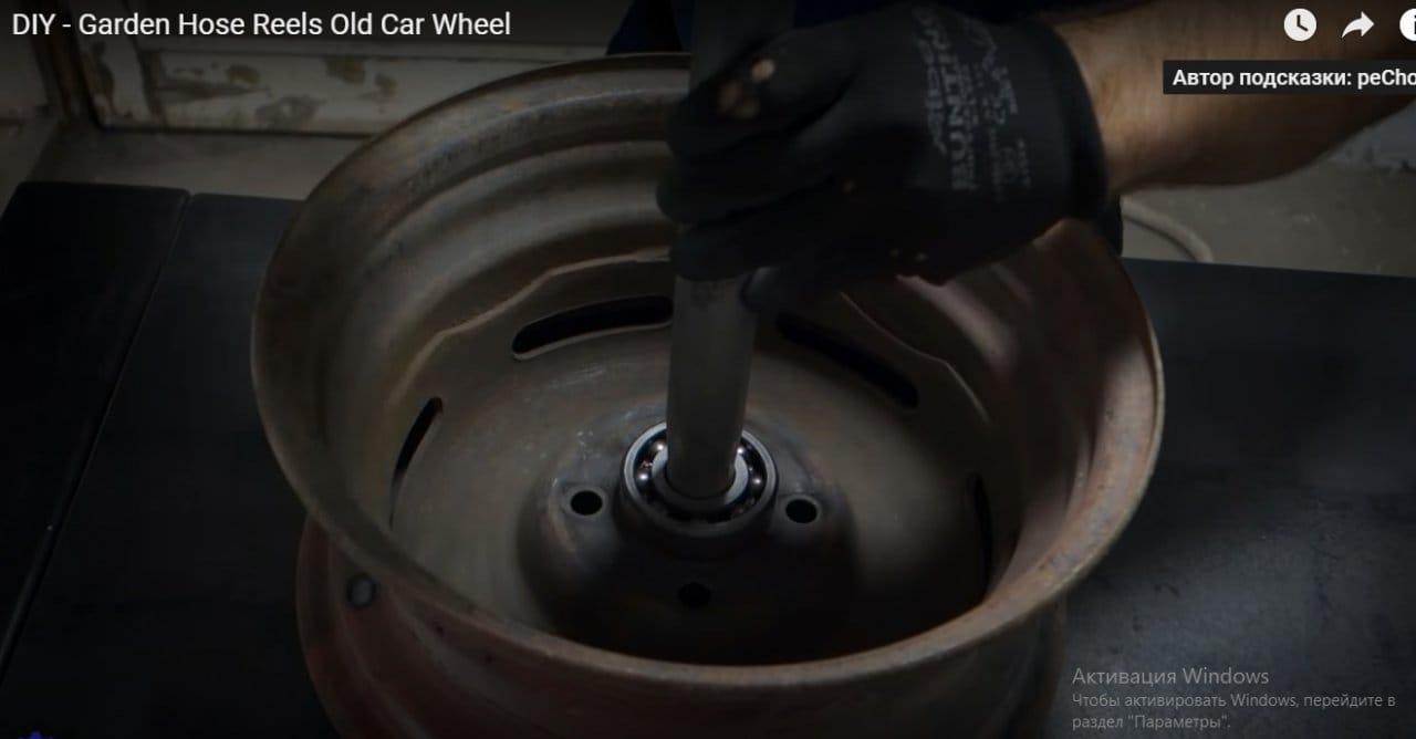 Катушка для поливочного шланга из металлолома и автомобильного диска