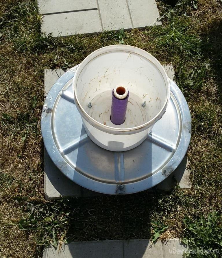 Катушка для хранения поливочного шланга