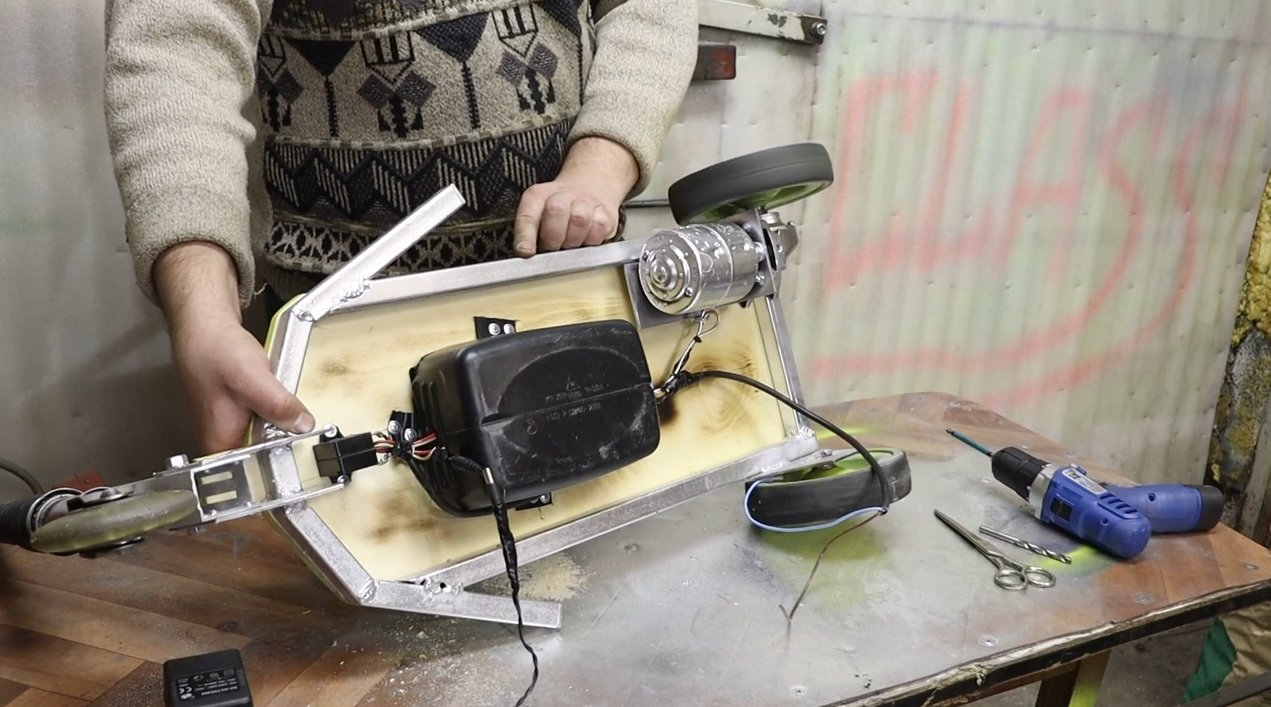 A simple scooter with a motor from the wipers and a gear from the angle grinder