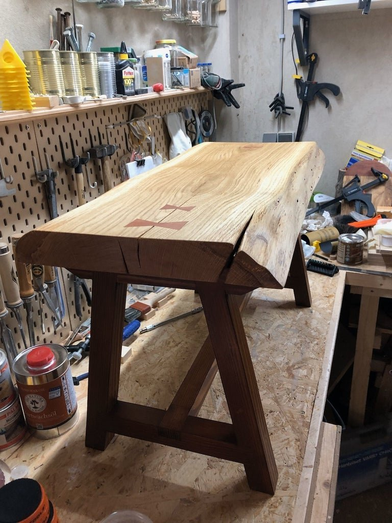 Coffee table in the form of a bench in a rustic style