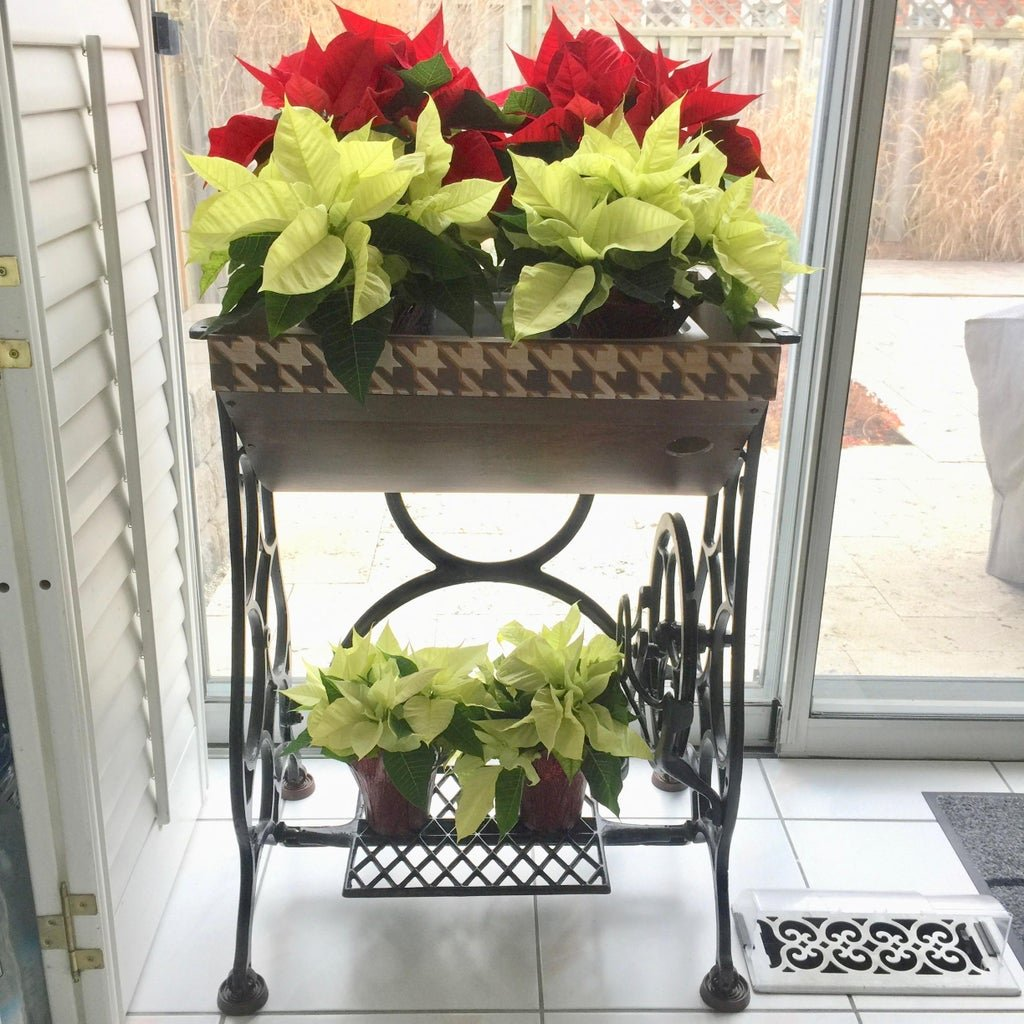 Stand for flower pots from an old sewing machine