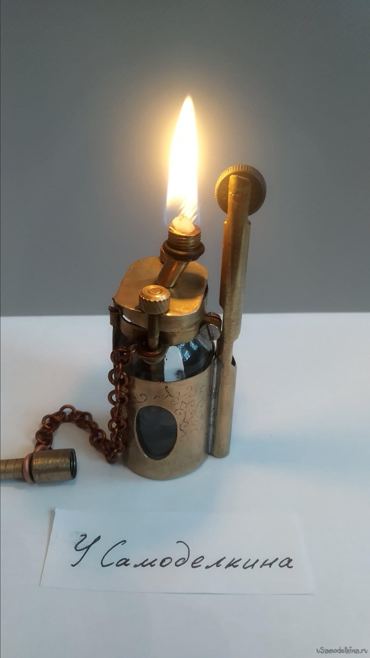 Homemade gasoline lighter made of glass vial and brass