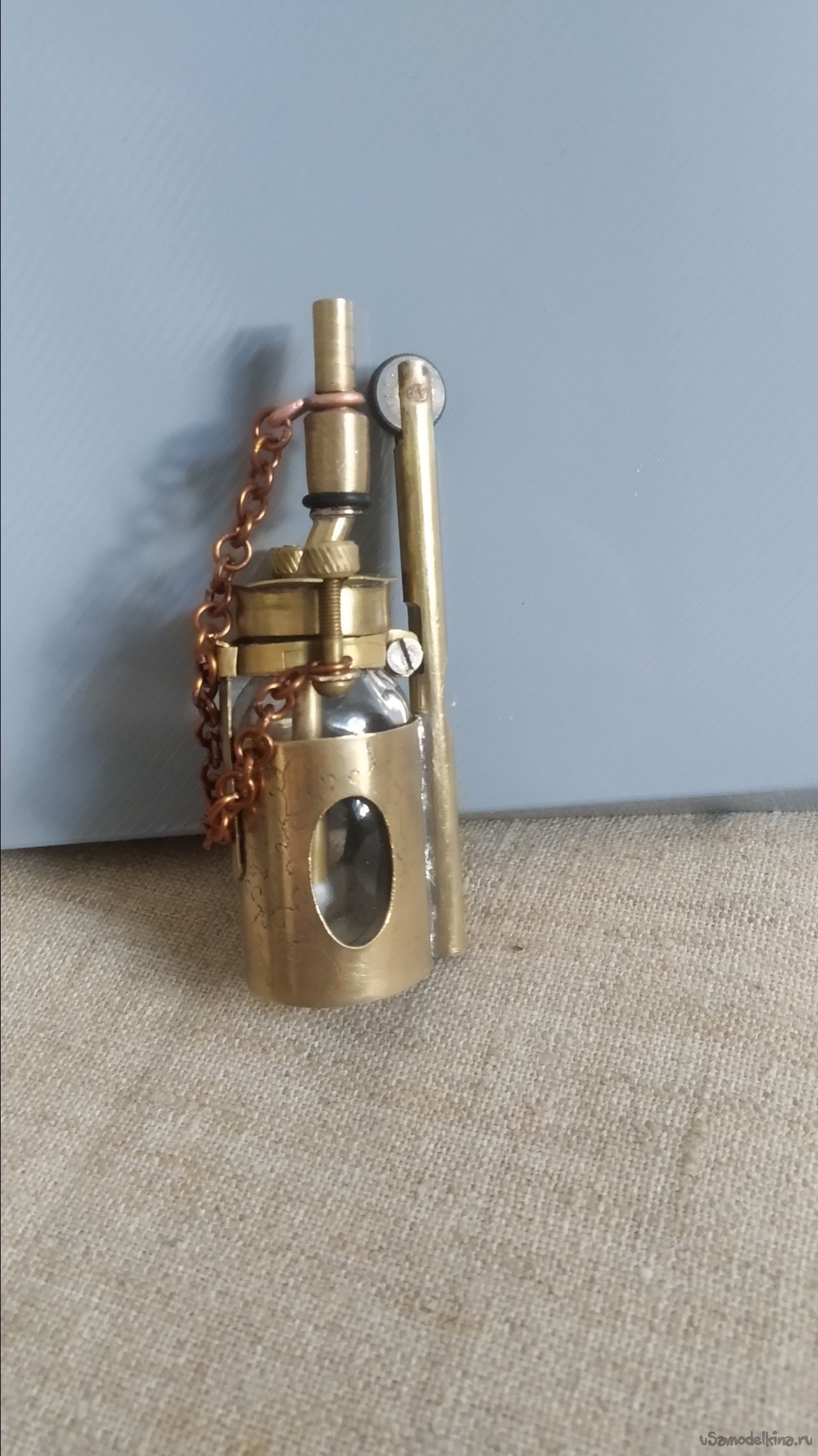Homemade gasoline lighter made of glass bubble and brass