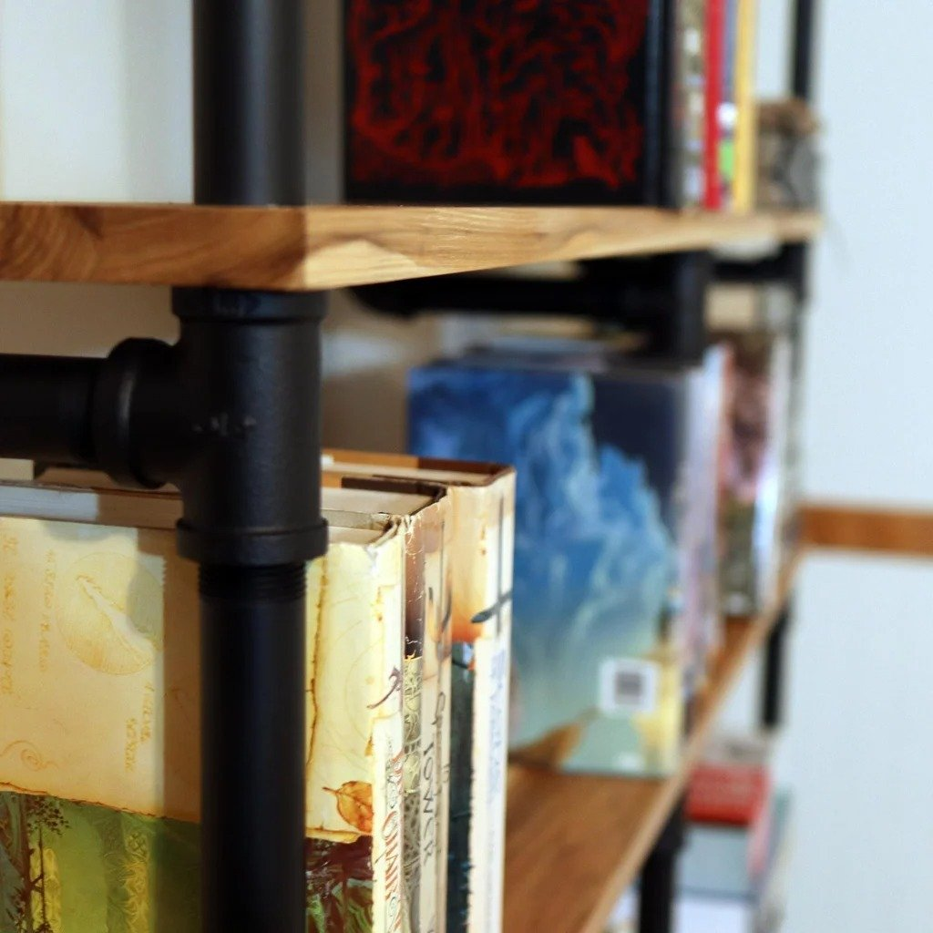 Bookshelf made of water pipes and boards