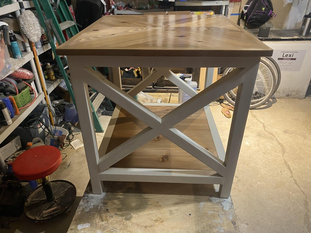Two tables with a chevron pattern on the table top