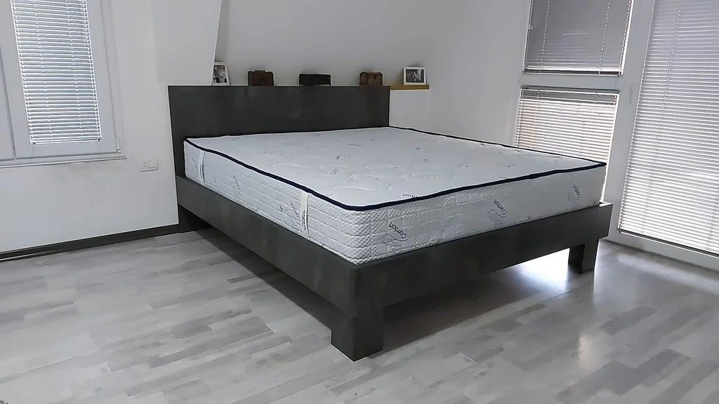 Double bed made of a profile pipe and chipboard