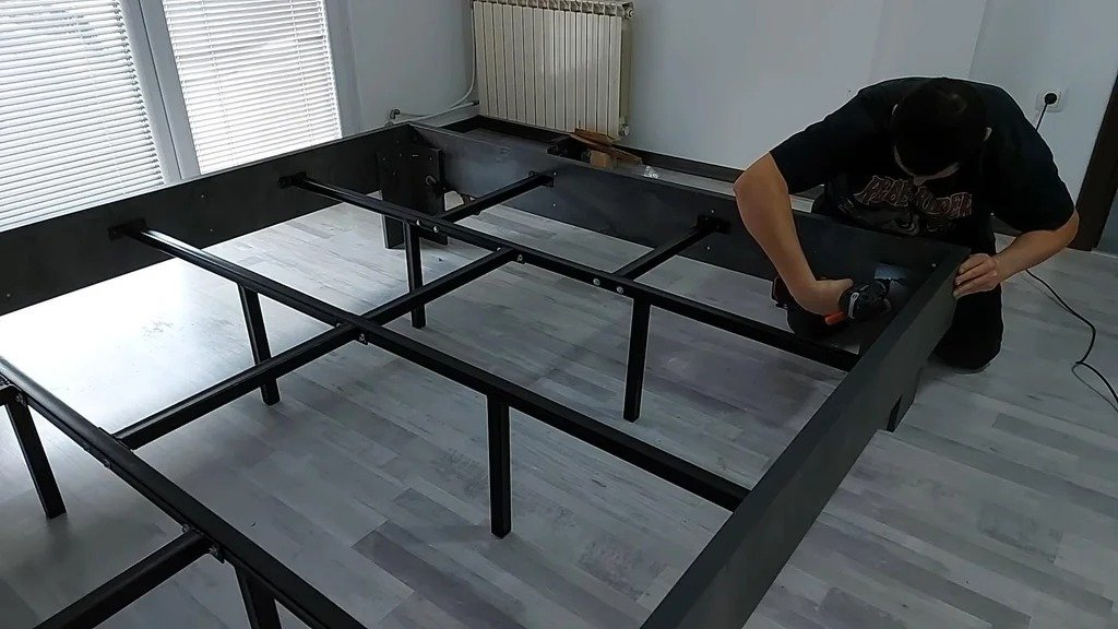 Double bed made of profile pipe and chipboard