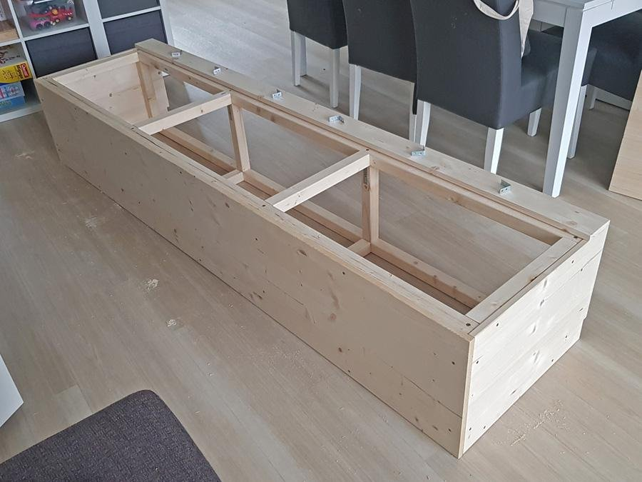 Frame sofa made of timber and furniture boards with storage compartments