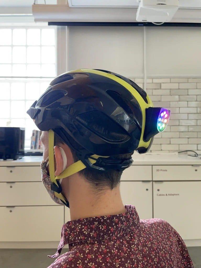 Side light for a cyclist helmet