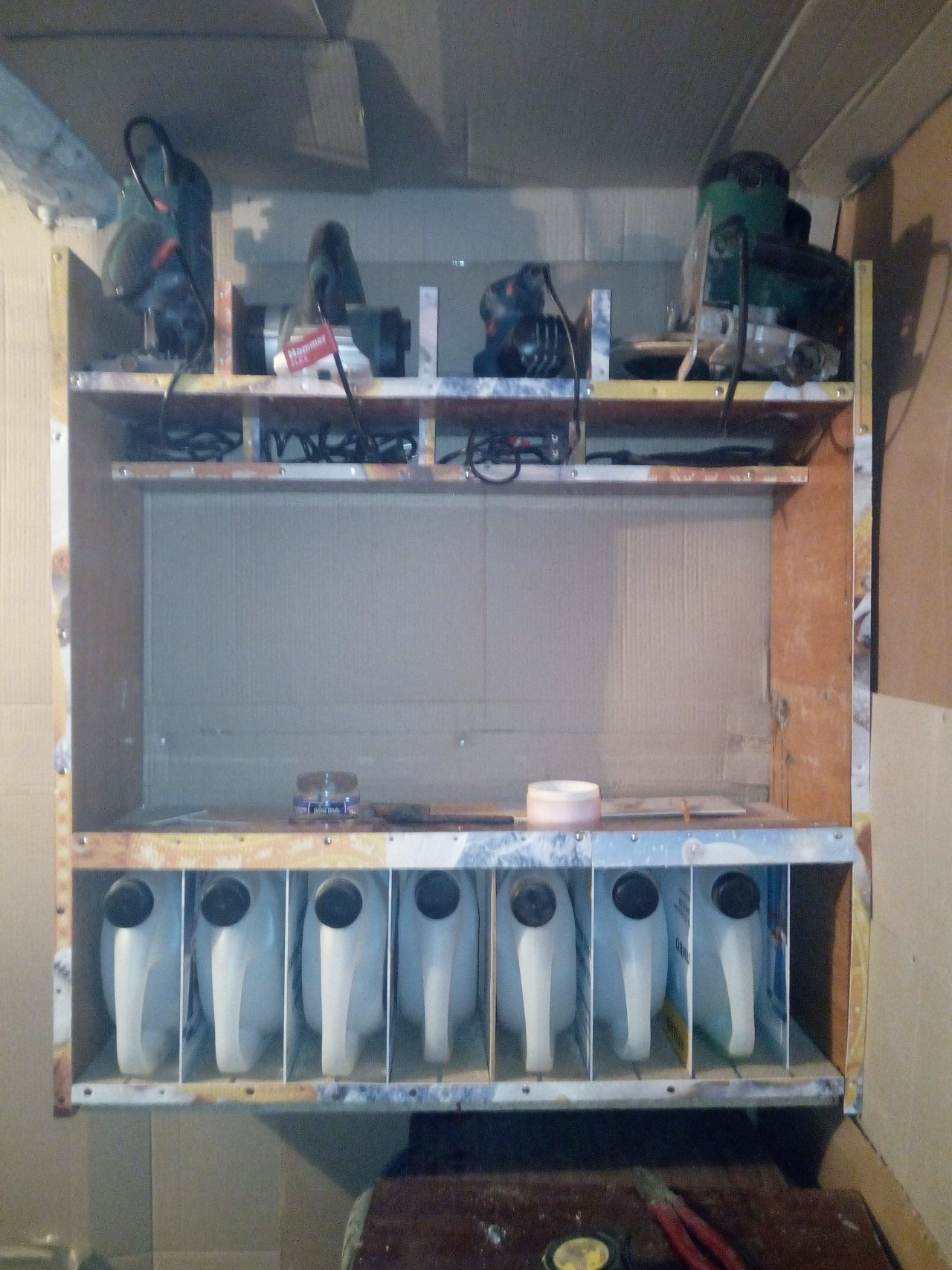 Hinged shelf-cabinet for storing power tools with boxes for hardware from cans