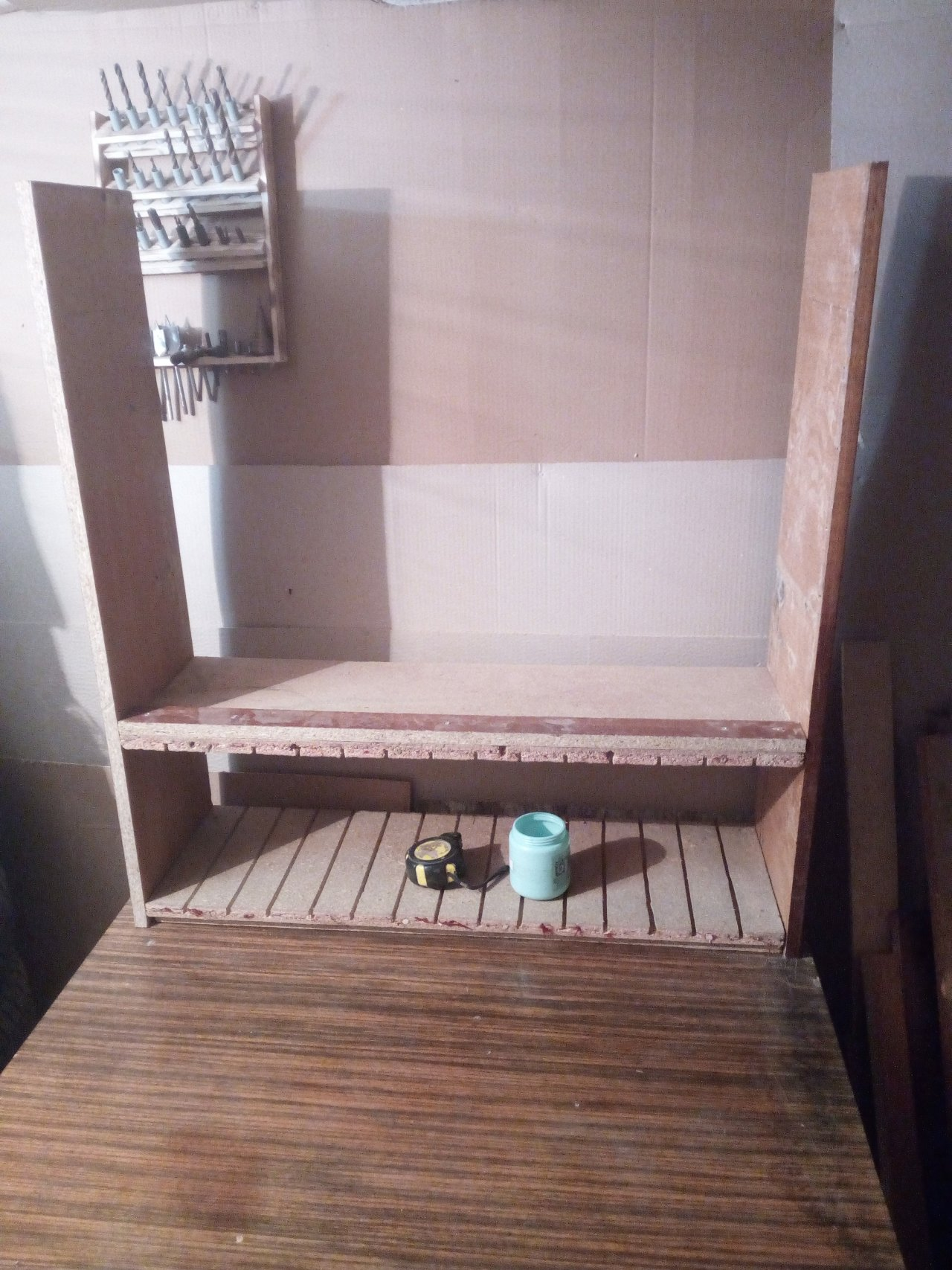Hinged shelf-cabinet for storing power tools with boxes for hardware from canisters