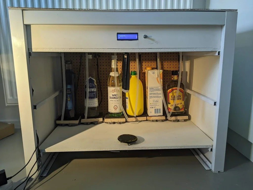 Automatic cocktail and beverage dispenser