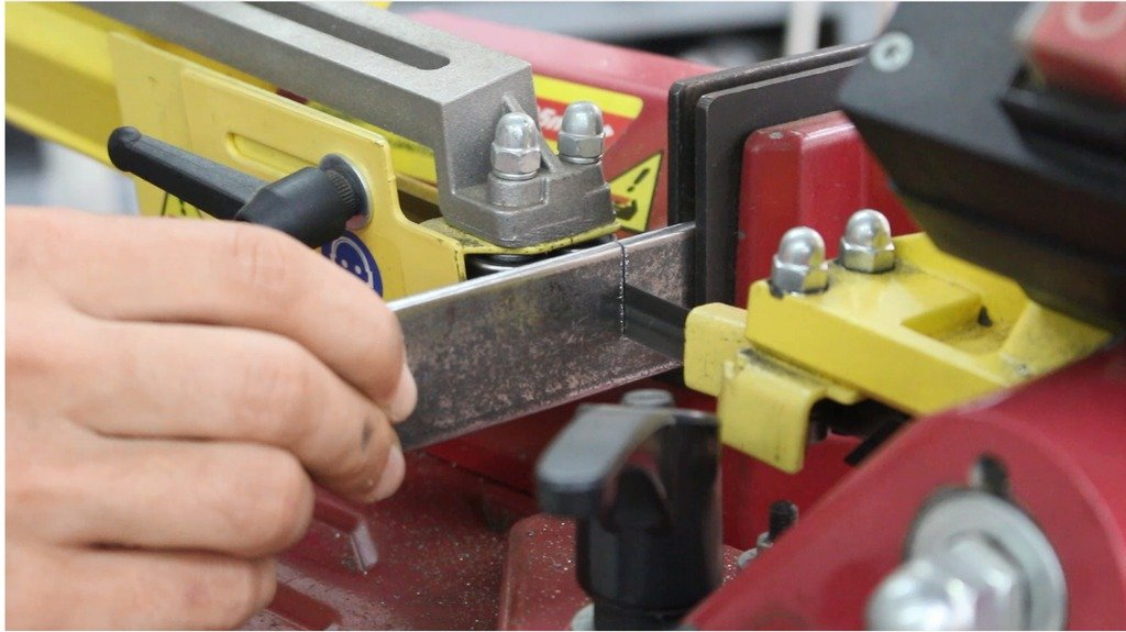 Tool for bending metal strip