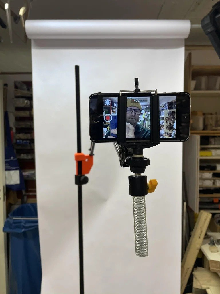 Stand-holder for a smartphone, to help a DIYer