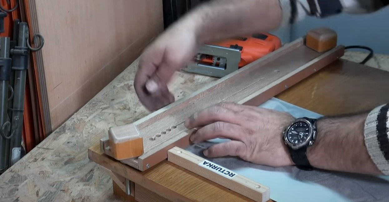 Tabletop with a guide for a jigsaw