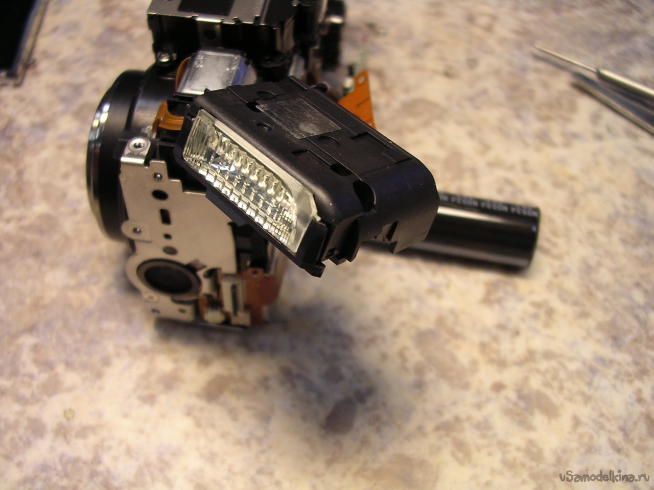 Repairing a folded lens for Canon PowerShot S80