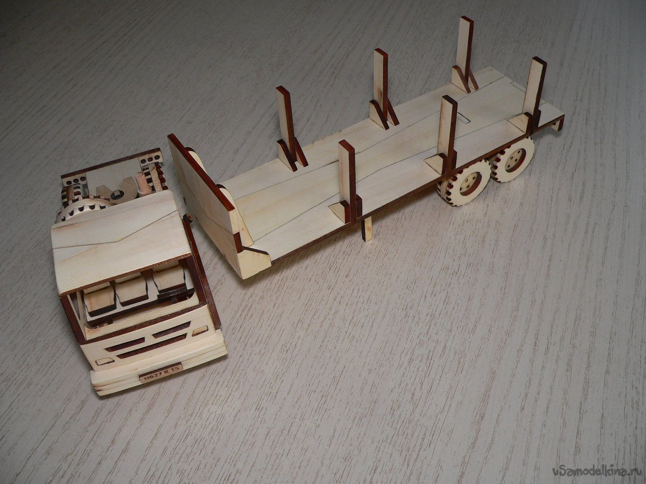Toy logging car made of wood