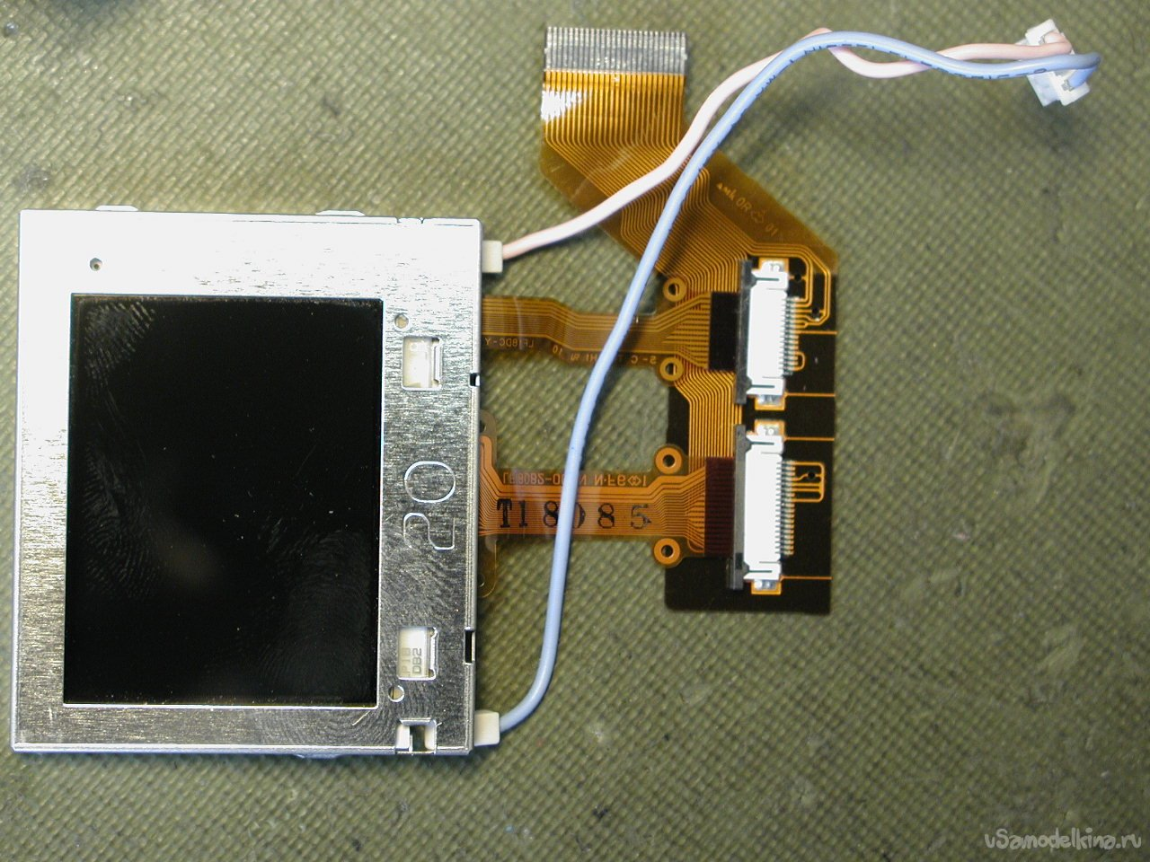 Incomplete disassembly of the Fujifilm FinePix 2600 camera