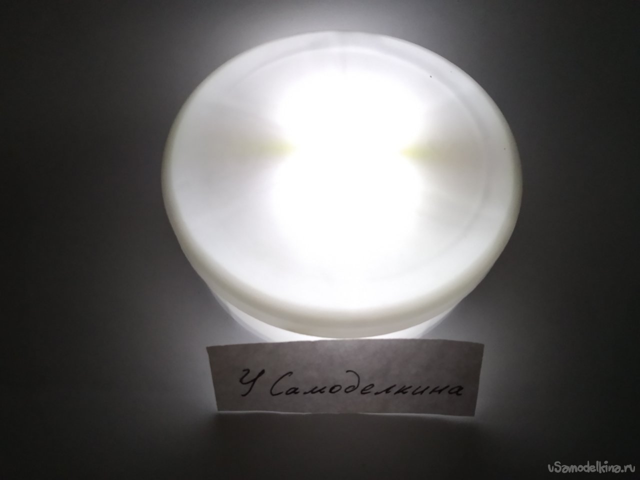 Night light with battery power and gravitational switch